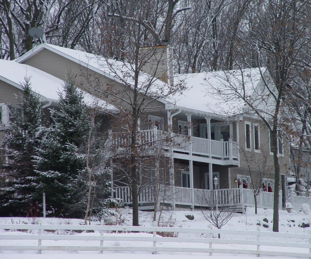 Inn with Snow and Wreaths on Doors