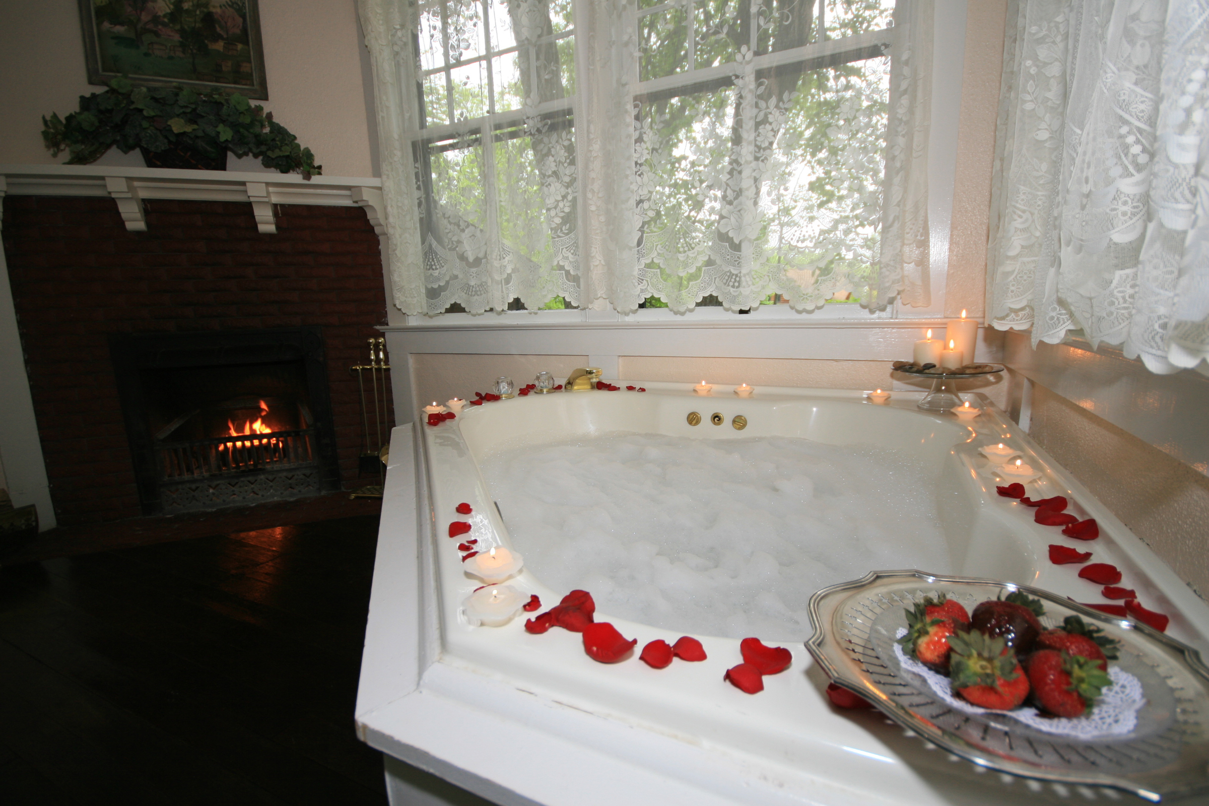 Enjoy a whirlpool tub and watch the flames dance in the fireplace.
