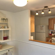 Dining area with pass through to the nicely-equipped kitchen