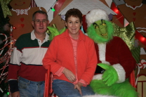 Enjoy the holiday season.  Kathy and Mike with The Grinch.