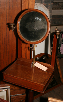 An antique oak shaving stand.