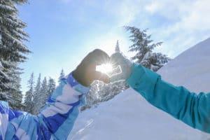 romantic couple on ski slope