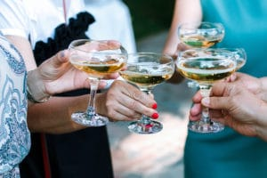 Hands toasting with champagne glasses