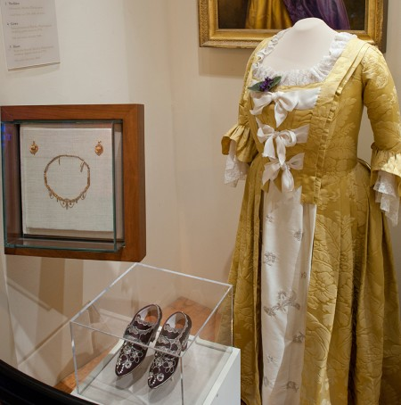 Visitors to Mount Vernon can see reproductions of Martha Washington's gold silk damask wedding dress and sequin-covered shoes in the museum (MVLA)
