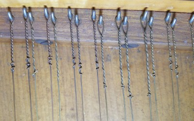 Some strings may be original, but past replacements are difficult to distinguish