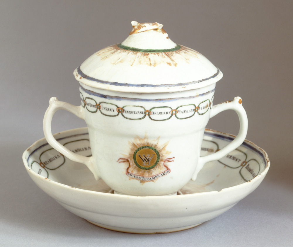 "In the mid-1790s, Dutch merchant Andreas Everardus van Braam Houckgeest designed a Chinese porcelain service specifically to present as a gift to First Lady Martha Washington. This cup and saucer is one of the few remaining pieces of the service. The cup is emblazoned with Martha's initials, and both pieces display the linked names of the fifteen states of the Union. A Latin inscription under Martha's initials translates as, ""Our Union is our Glory, and our Defense against Him [i.e. England's King George III]."" (Mount Vernon Ladies' Association)"