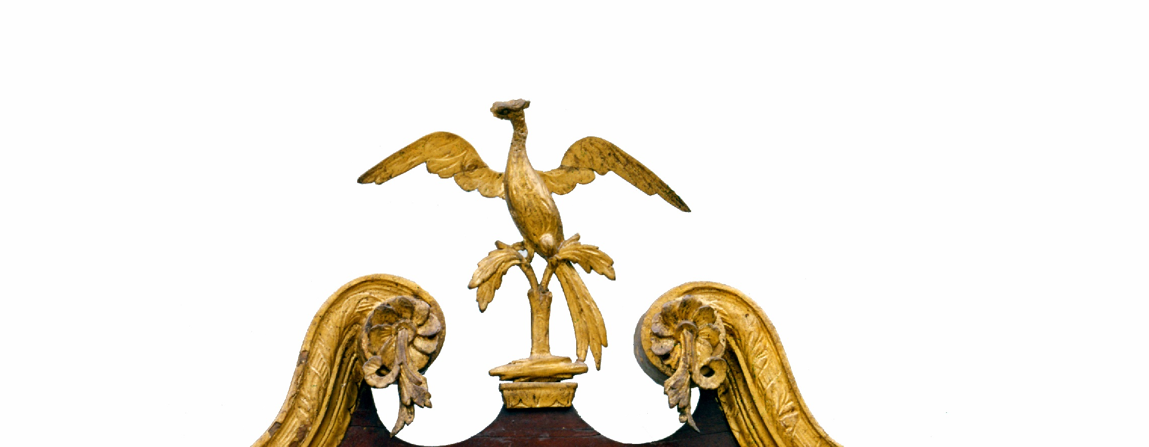 The reproduction finial will be modeled on this original phoenix finial, from a Washington-owned looking glass (MVLA -W-2181).