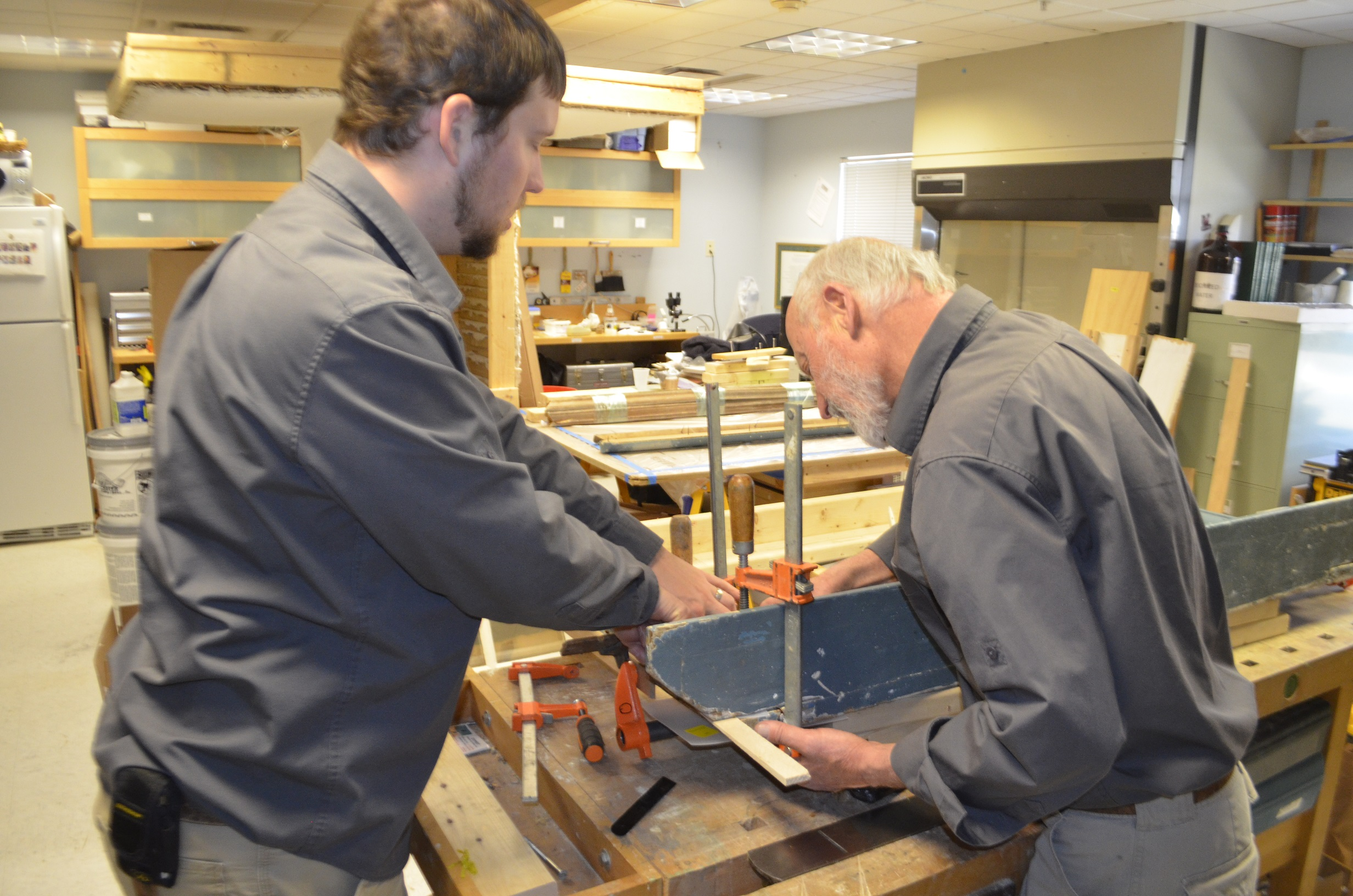 Architectural Conservator, Steve Stuckey, and Head Preservation Carpenter, John O'Rourke, executing mantel repairs.