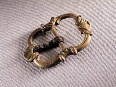 "This shoe buckle was found during archeological excavations of the ""House for Families,"" which was the main dwelling for household slaves at Mount Vernon until it was torn down in 1793. The buckle was likely passed down from a member of the household to a slave. (Mount Vernon Ladies' Association)"