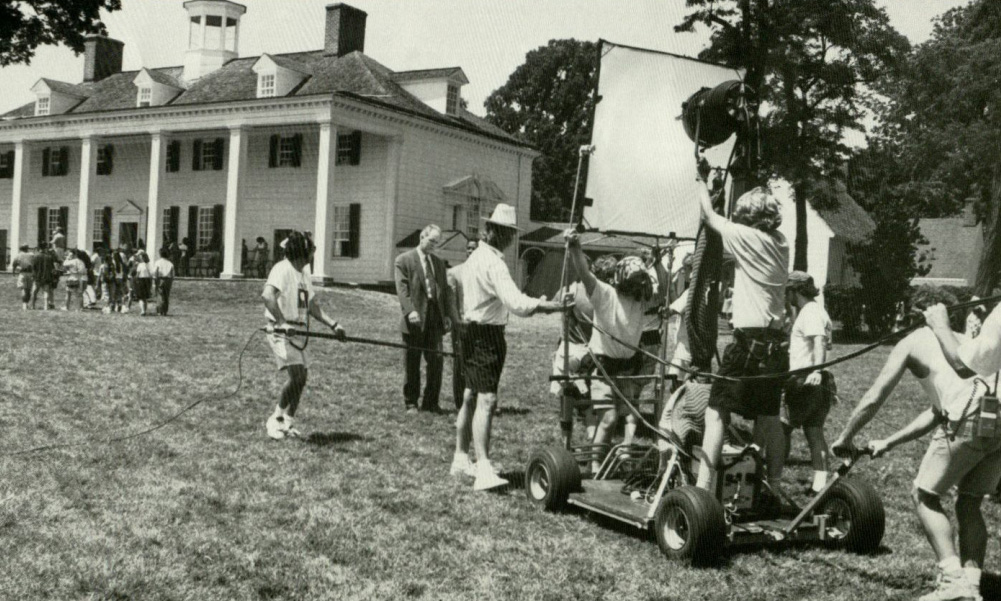 Actors John Lithgow and Denzel Washington (partially hidden) enact a scene on Mount Vernon's easy lawn. (Ken Regan/Warner Brothers)