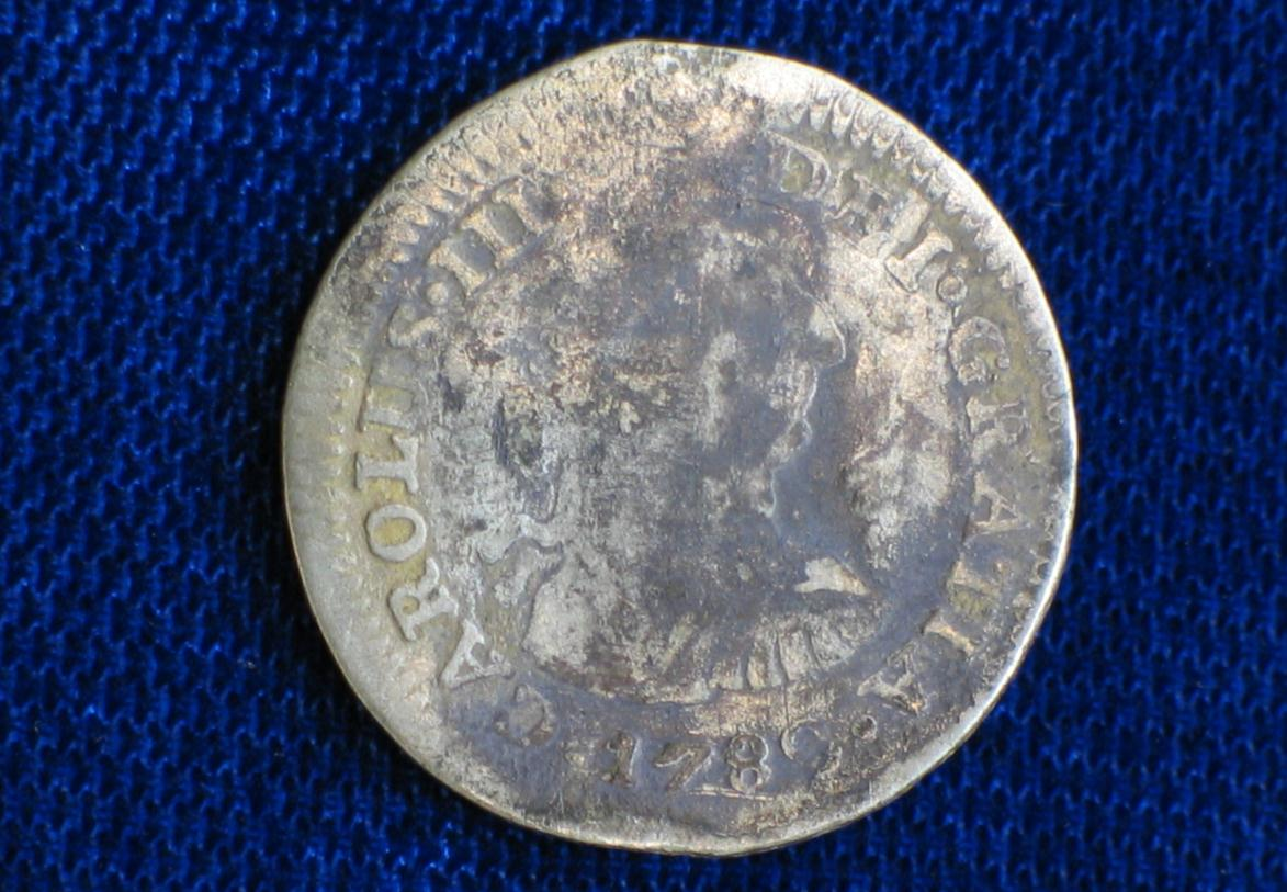 View of the 1780s Spanish half real coin uncovered at the Porter's Lodge site (Mount Vernon Ladies' Association)
