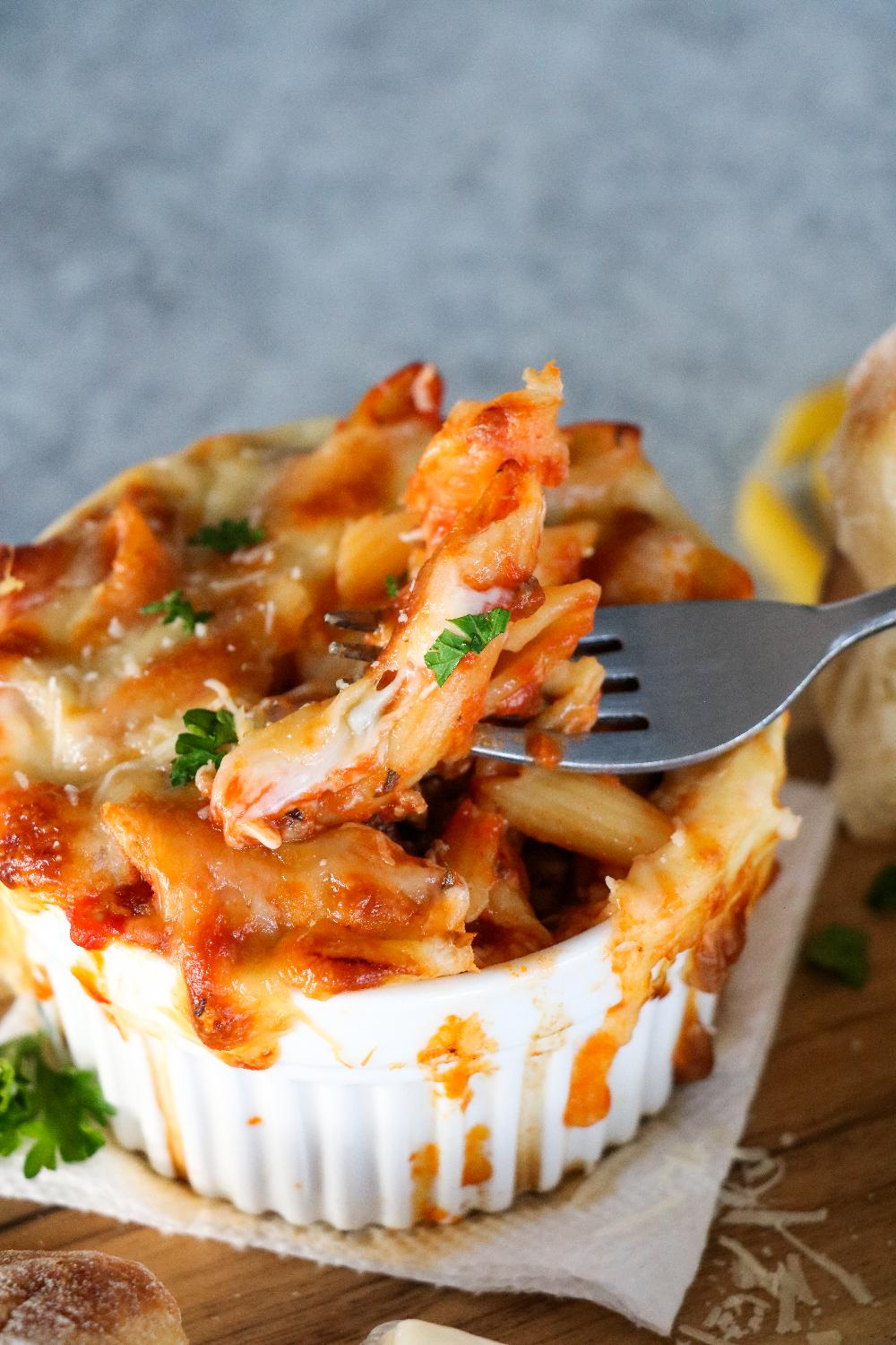 A forkful of Baked Ziti with fresh parsley.