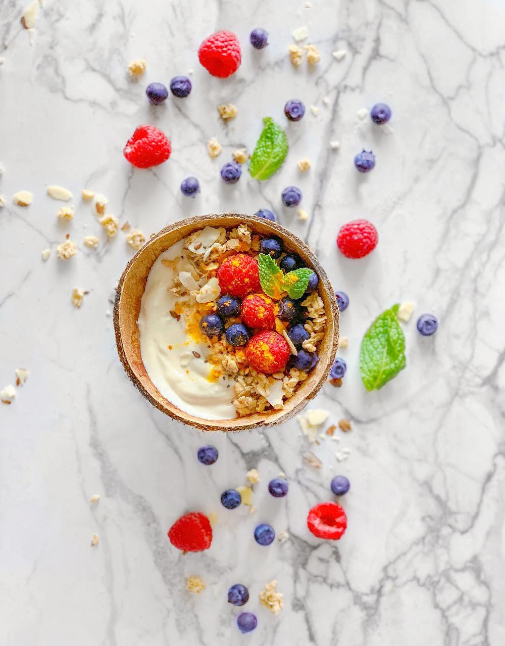 winter bliss bowls using granola, yogurt, fruits and turmeric