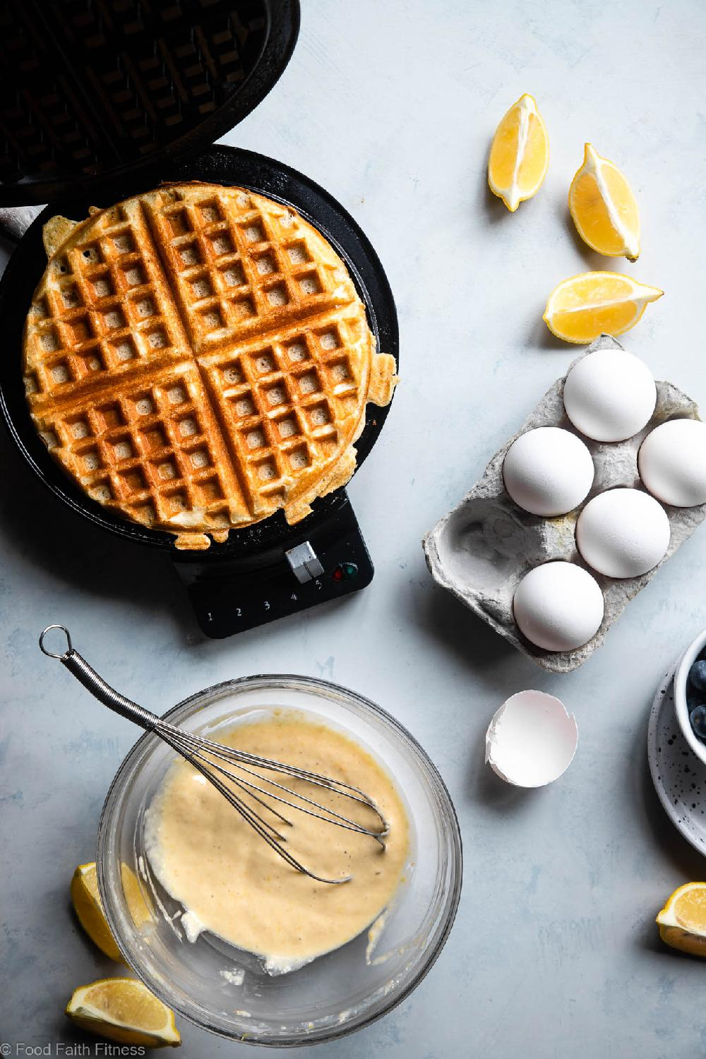 Lemon Blueberry Gluten Free Greek Yogurt Waffles - These gluten free waffles are so crispy and fluffy you will never believe they're low fat, oil free, protein packed and only 170 calories! | #Foodfaithfitness | #Glutenfree #Lowfat #Healthy #Waffles #Breakfast