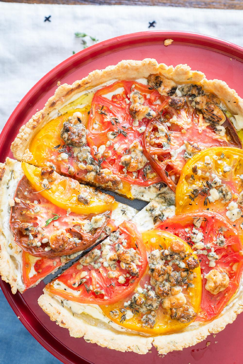 Heirloom Tomato Tart, Homemade crust topped with cream cheese spread, heirloom tomatoes, and gorgonzola cheese! #recipe from thissillygirlskitchen.com #tomato #tart #tomatotart #heirloomtomatotart