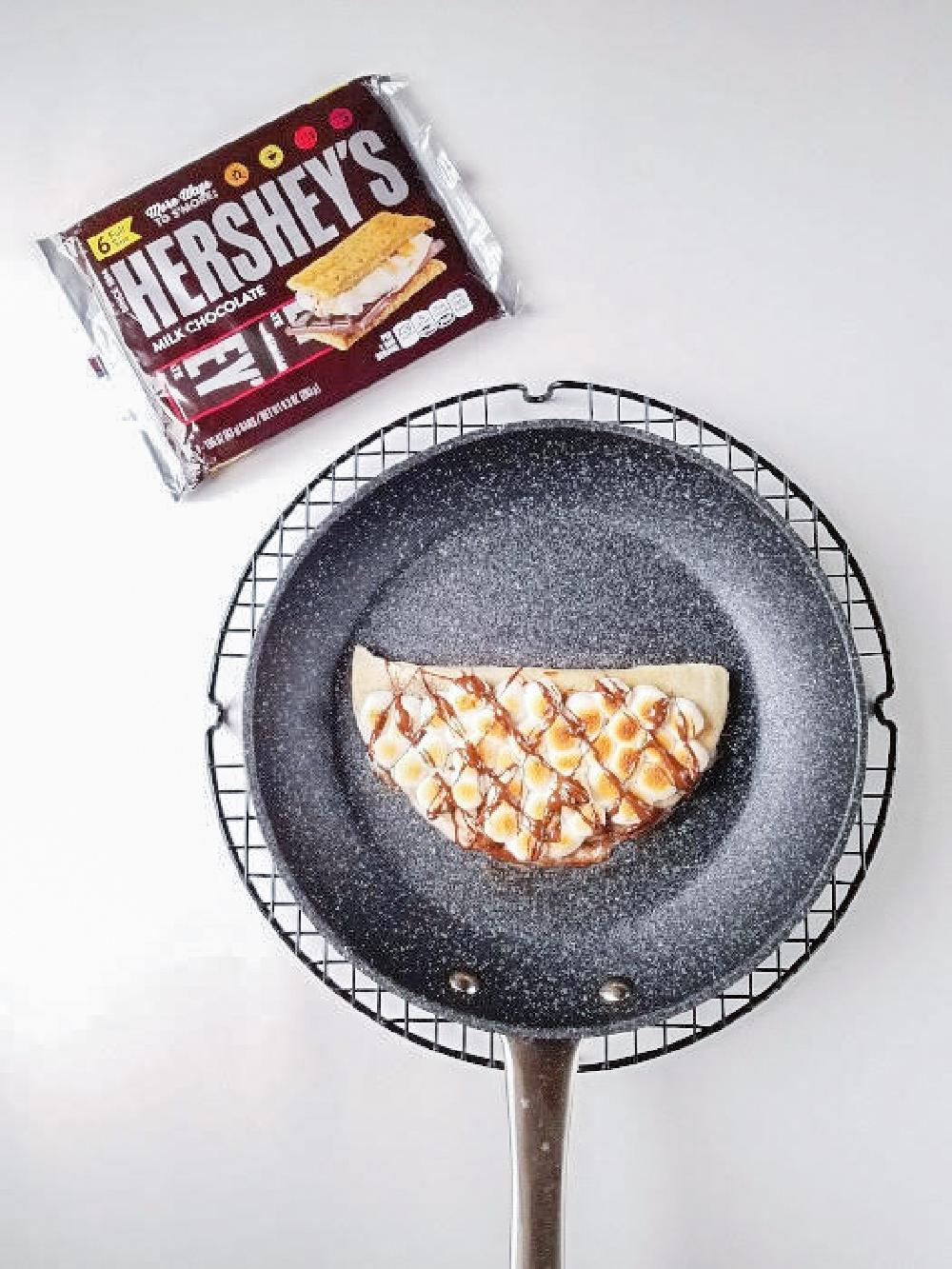 broiled smores quesadilla topped with melted chhocolate