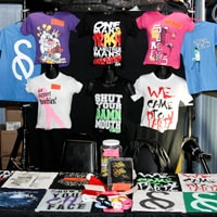 A merchandise table at a music event