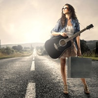 Female guitarist traveling to a gig without transport