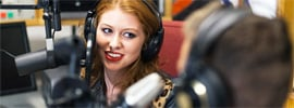 A musician getting interviewed on radio