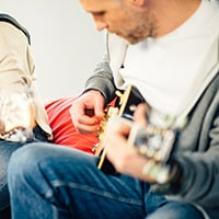 Top strategies for marketing offline and online guitar lessons for guitar teachers