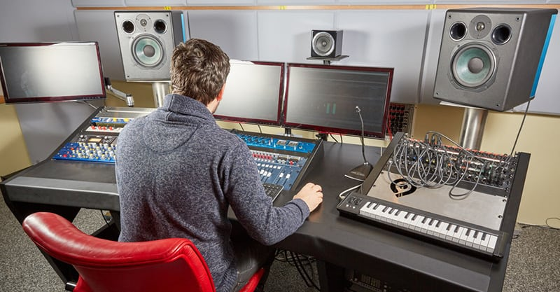 A man earning a living as a sound engineer and recording