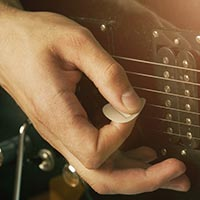 Best Way To Hold A Guitar Pick For Strumming Speed