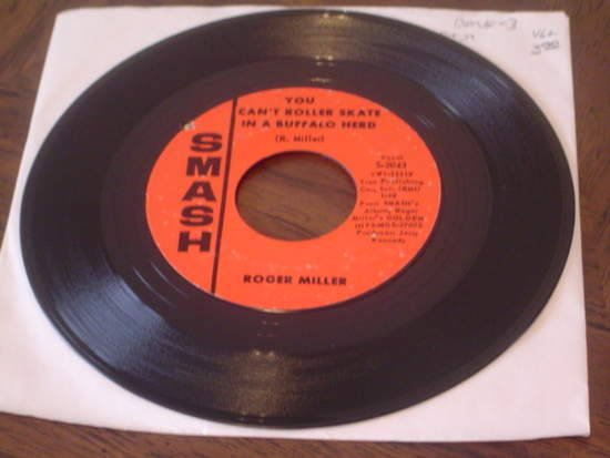 """Roger Miller - You Can't Roller Skate In A Buffalo Herd / Train Of Life - 7"""""""