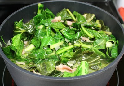 Stir the greens and add more to the pot