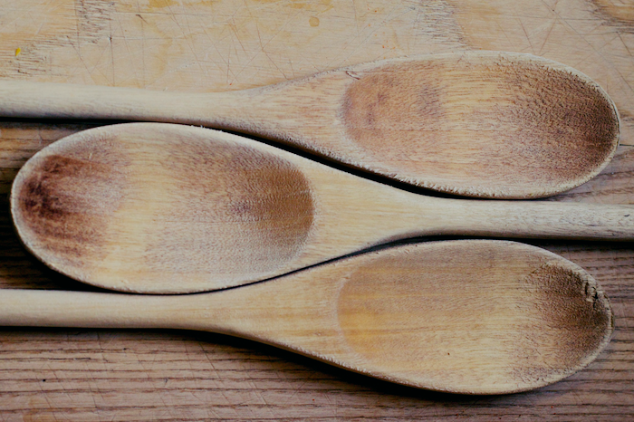 A series of three wooden spoons.