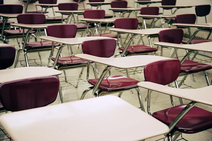 A row of school desks in a classroom.