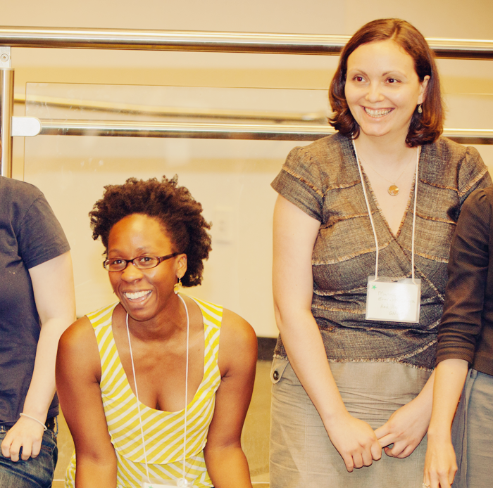 Four AdaCamp attendees smiling at the conference.