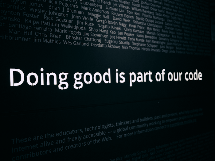 Image that says 'Doing good is part of our code.' Transposed across the background are many names.