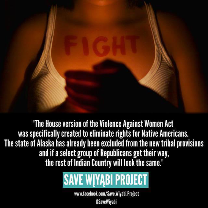 A poster for the Save Wiyabi Project shows a person, their face not pictured, wearing a tank top with the word Fight written across their collarbone area, and holding a candle, the soft light illuminating the word. Beneath, the poster fades to black with white text: The House version of the Violence Against Women Act was specifically created to eliminate rights for Native Americans. The state of Alaska has already been excluded from the new tribal provisions and if a select group of Republicans get their way, the rest of Indian Country will look the same.