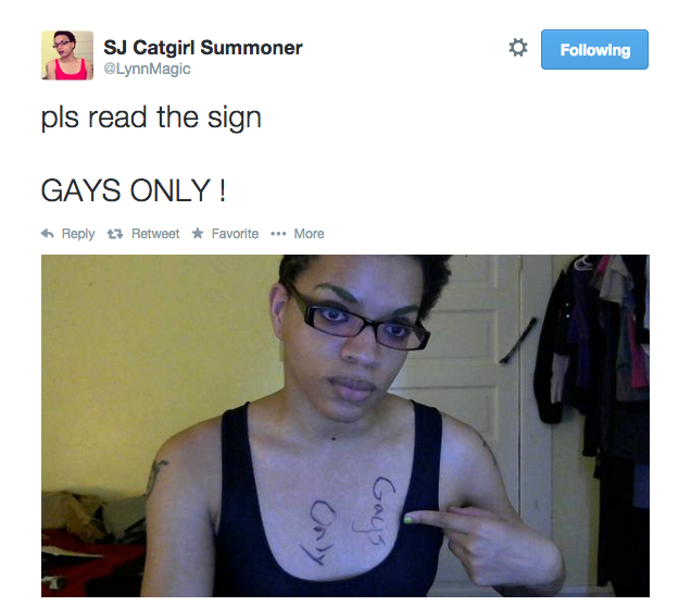 A tweet from user LynnMagic that reads 'pls read the sign. GAYS ONLY !' Attached is a photo of the author pointing to the words 'gays only' written sideways on her chest.