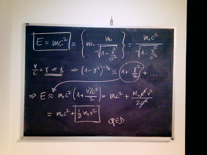 Image of math equations drawn on a chalkboard.