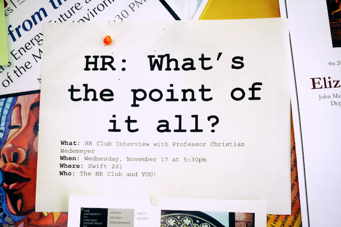 A sign on a bulletin board that reads 'HR: What's the point of it all?'