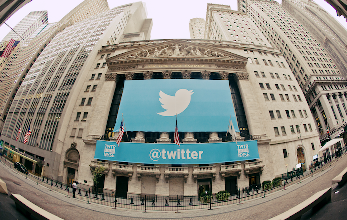 A large Twitter banner draped over the New York Stock Exchange building.