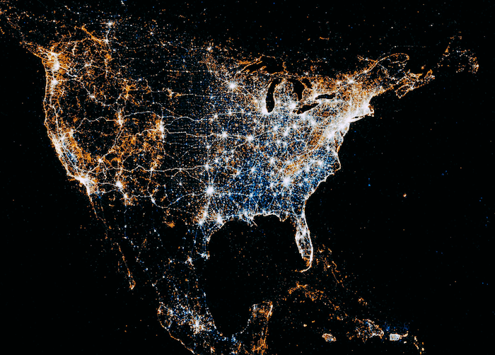 A visualization of locations of Flickr pictures and Tweets across the US, Mexico and the Caribbean. Many points of red and blue light up the map.