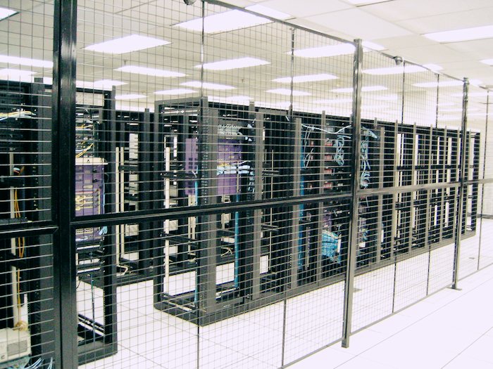 Racks in a brightly-lit datacenter.