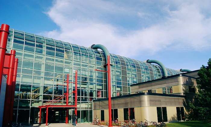 Picture of the University of Waterloo Computer Research Center, a large glass, modern building.