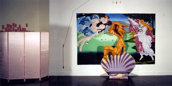 View of Venusification installation. A pink satin dressing screen is to the left. In the center of the photo, a shell platform and a background mural based on Botticelli's 'The Birth of Venus,' while in the foreground a large golden paper maché  wig hovers suspended from a pulley.