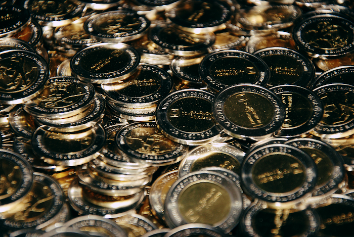 A pile of golden, generic tokens.