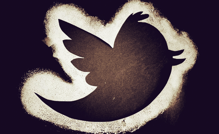 A cutout of the twitter bird logo, with white chalk outlining it.