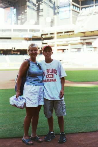 Jonathan and his mom, Mary Beth on the field.