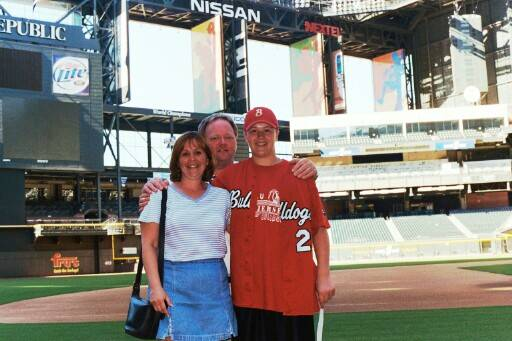 Bobby, his mom Ginny, and Coach Spindler on the field at Bank One.