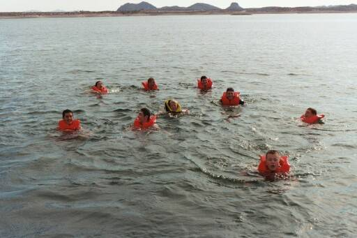 The entire team took a dip in Lake Pleasant. No one wanted to wear life vests, but coach made them.
