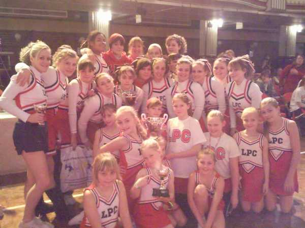 Team with Winning Trophies at Blackpool Cheerleading Competition