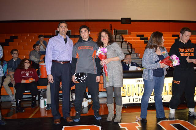 Frank Gesualdo is recognized on senior night with his parents.