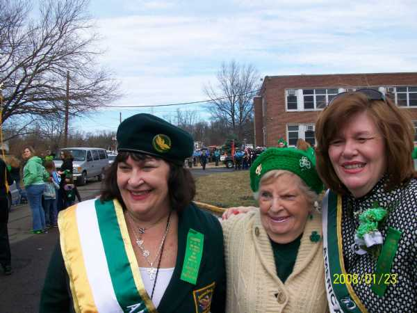 Past President Diane McGovern, Charter Member Marge Crofford and President Joan McNichol laugh as they get ready to march in the 36th annual Saint Patrick's Day Parade.