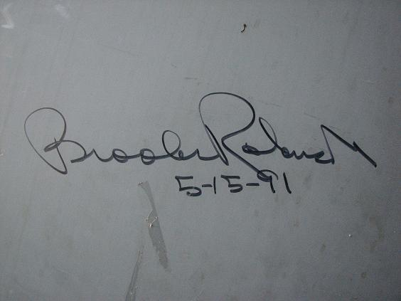 1991.  Brooks Robinson visited the Riviera Little League fields on May 15, 1991, and signed the inside of the Riviera Beach ES block house door.